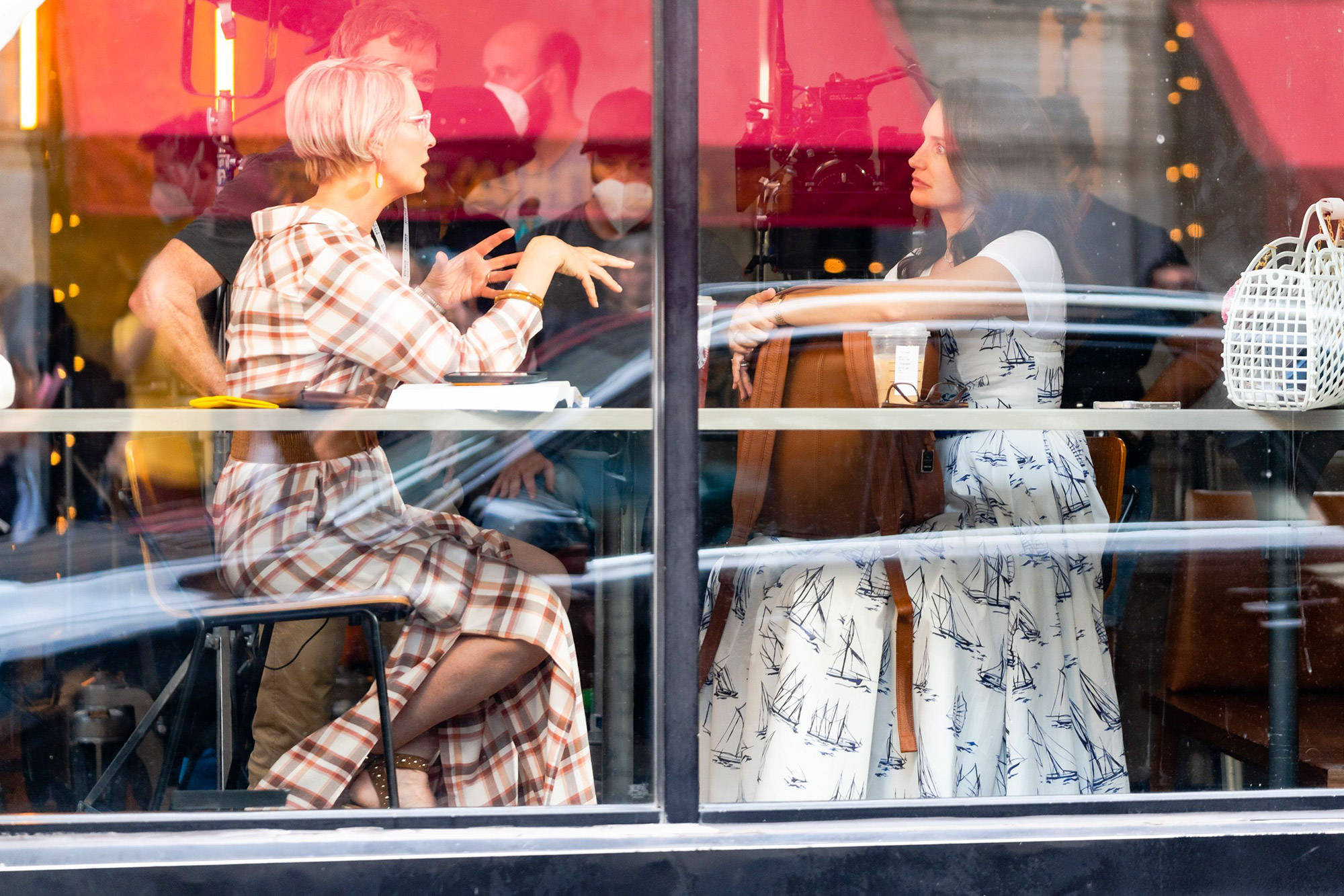 """Cynthia Nixon (L) and Kristen Davis are seen filming """"And Just Like That..."""" the follow up series to """"Sex and the City"""" in the East Village on July 19, 2021 in New York City"""
