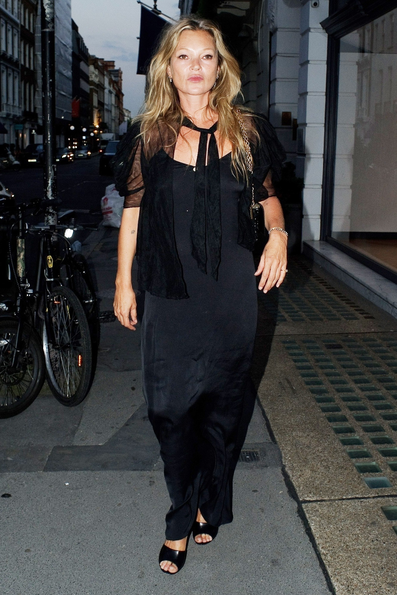 English supermodel and businesswoman, Kate Moss arriving at a party in Mayfair, London.