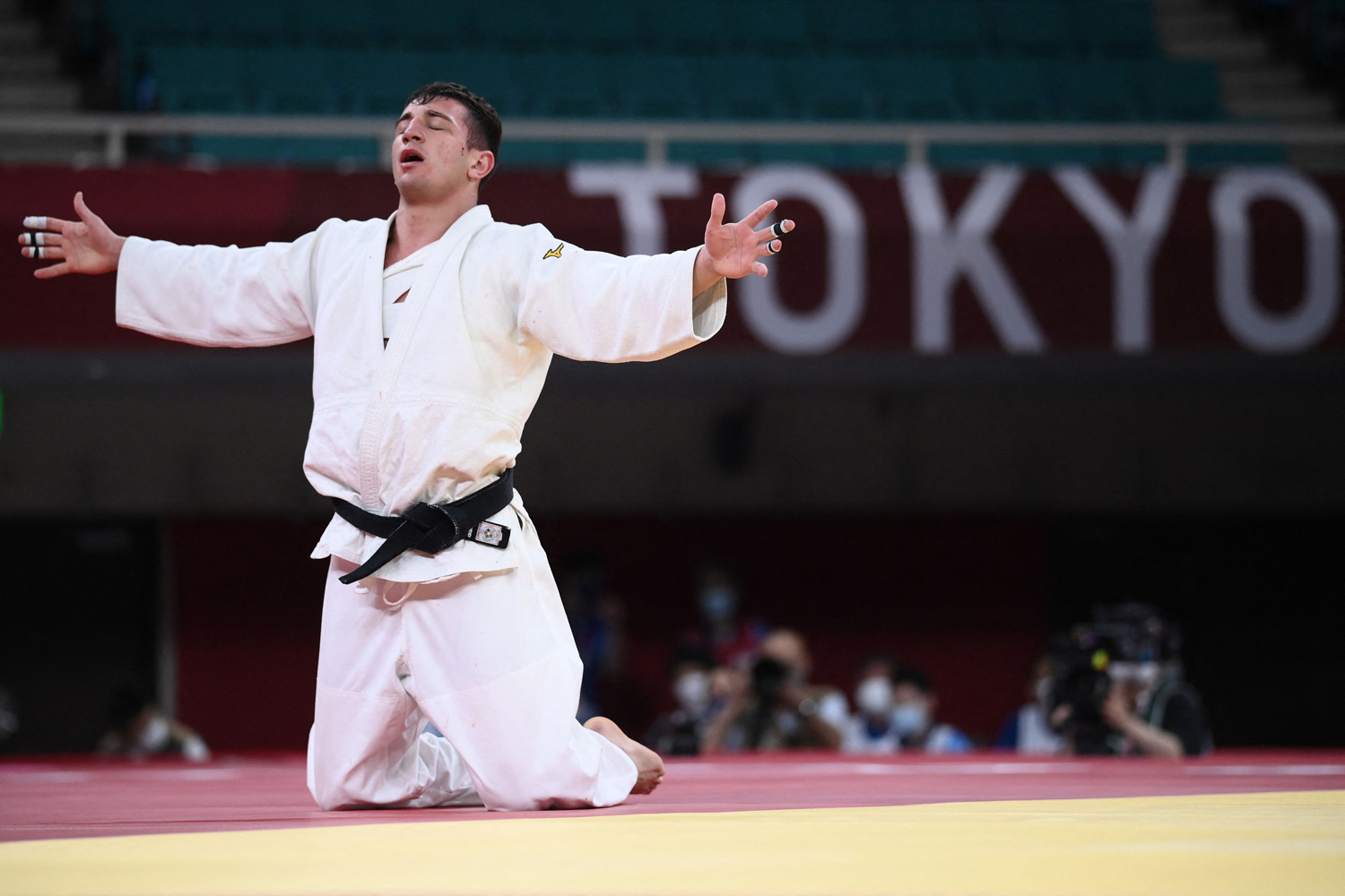 Georgia's Lasha Bekauri celebrates winning the judo men's -90kg gold medal bout against Germany's Eduard Trippel during the Tokyo 2020 Olympic Games