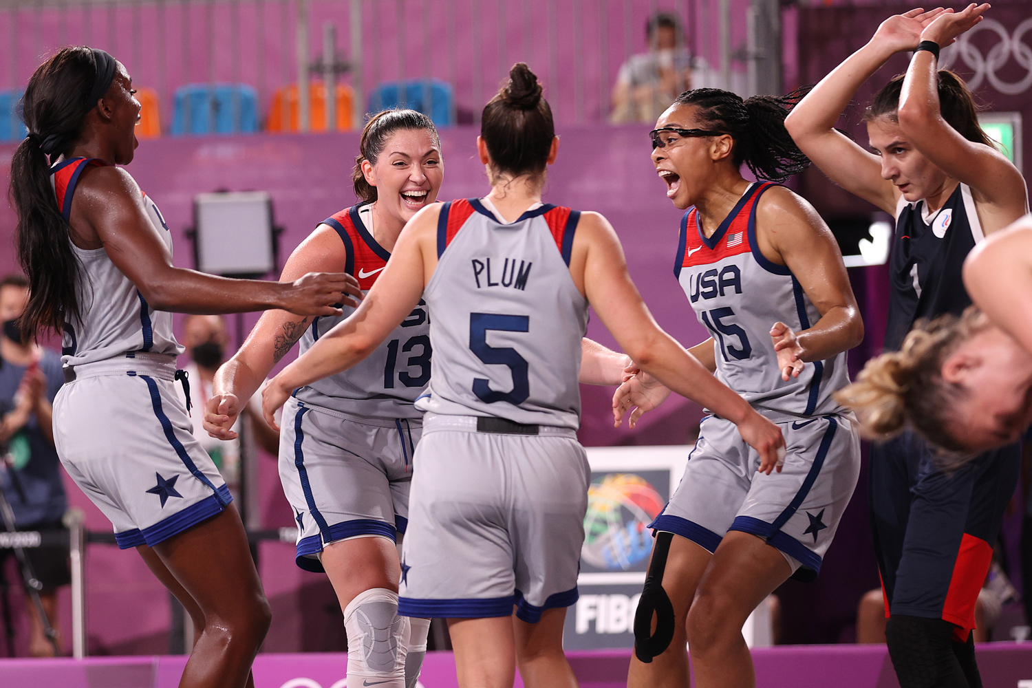 Jacquelyn Young, Stefanie Dolson, Kelsey Plum, and Allisha Gray of Team United States celebrate victory and winning the gold medal in the 3x3 Basketball competition