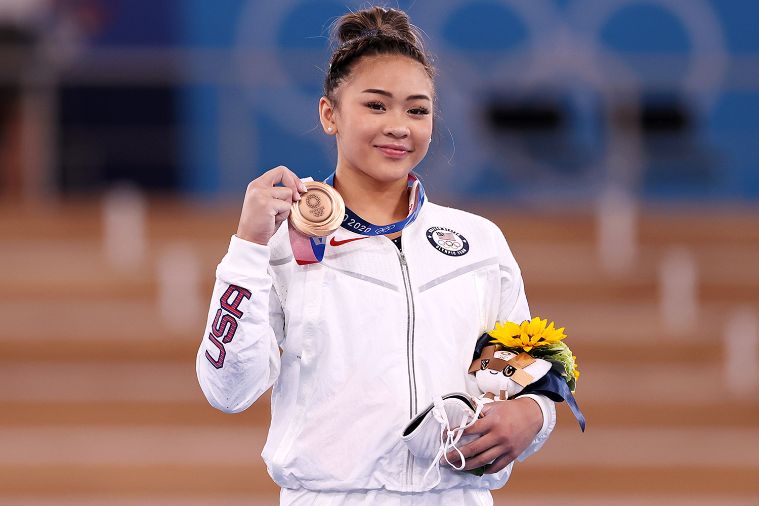 Bronze Medalist Sunisa Lee of Team United States poses with her medal on the podium during the Women's Uneven Bars Final medal ceremony on day nine of the Tokyo 2020 Olympic Games at Ariake Gymnastics Centre on August 01, 2021 in Tokyo, Japan.