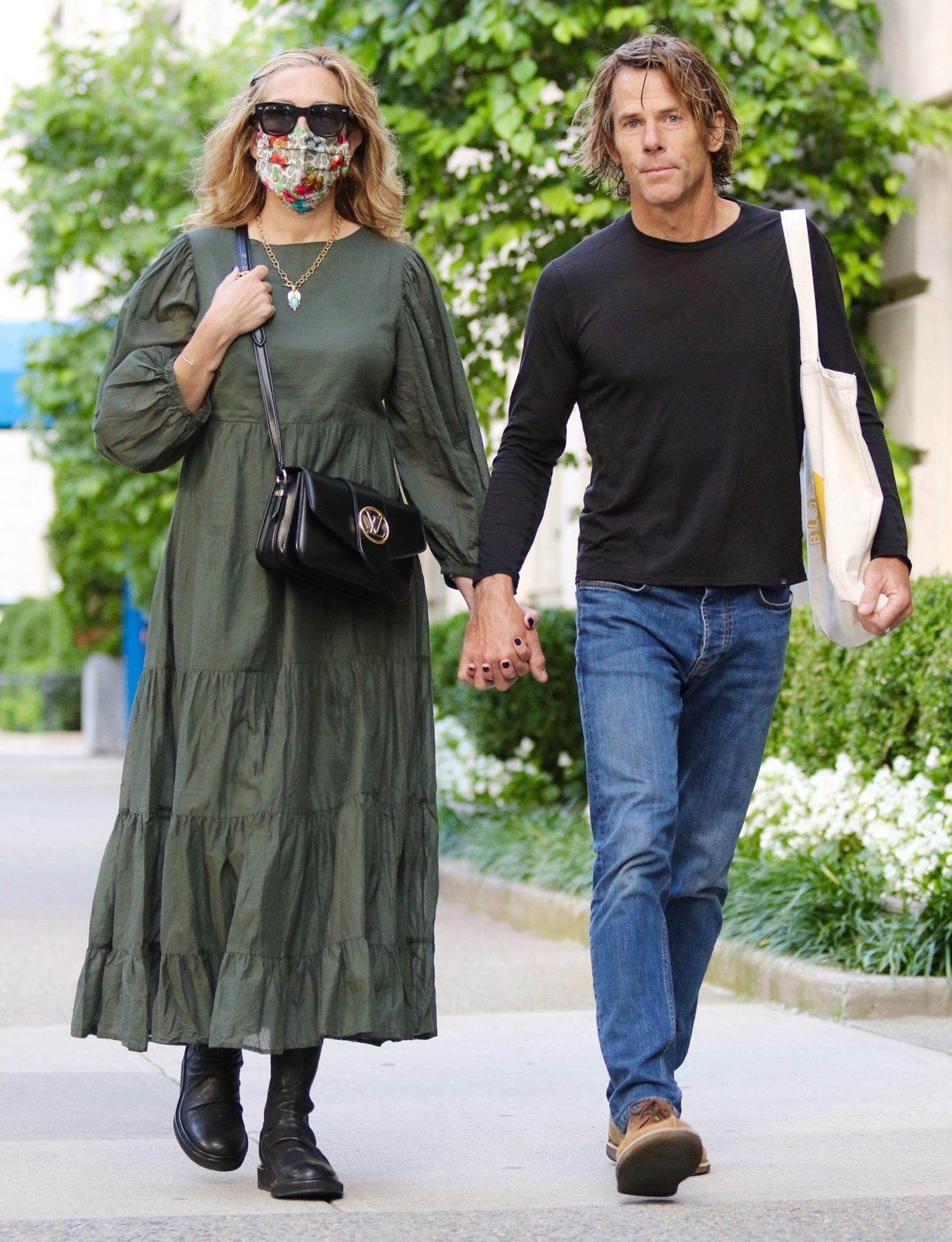 Julia Roberts and her husband Danny Moder hold hands during a romantic walk in Manhattan's Midtown area