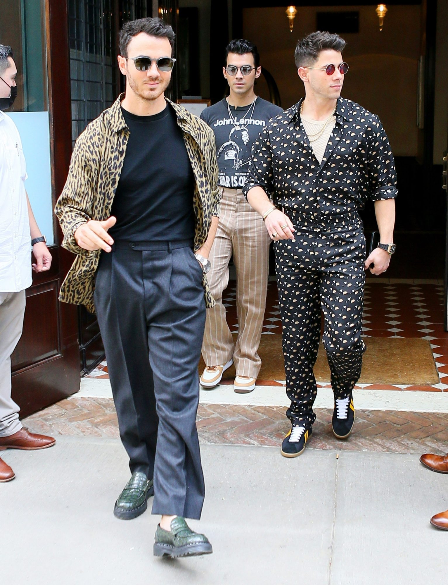 The Jonas Brothers, Nick, Kevin, and Joe Jonas, share their charming smile as they exit the Greenwich Hotel in NYC.