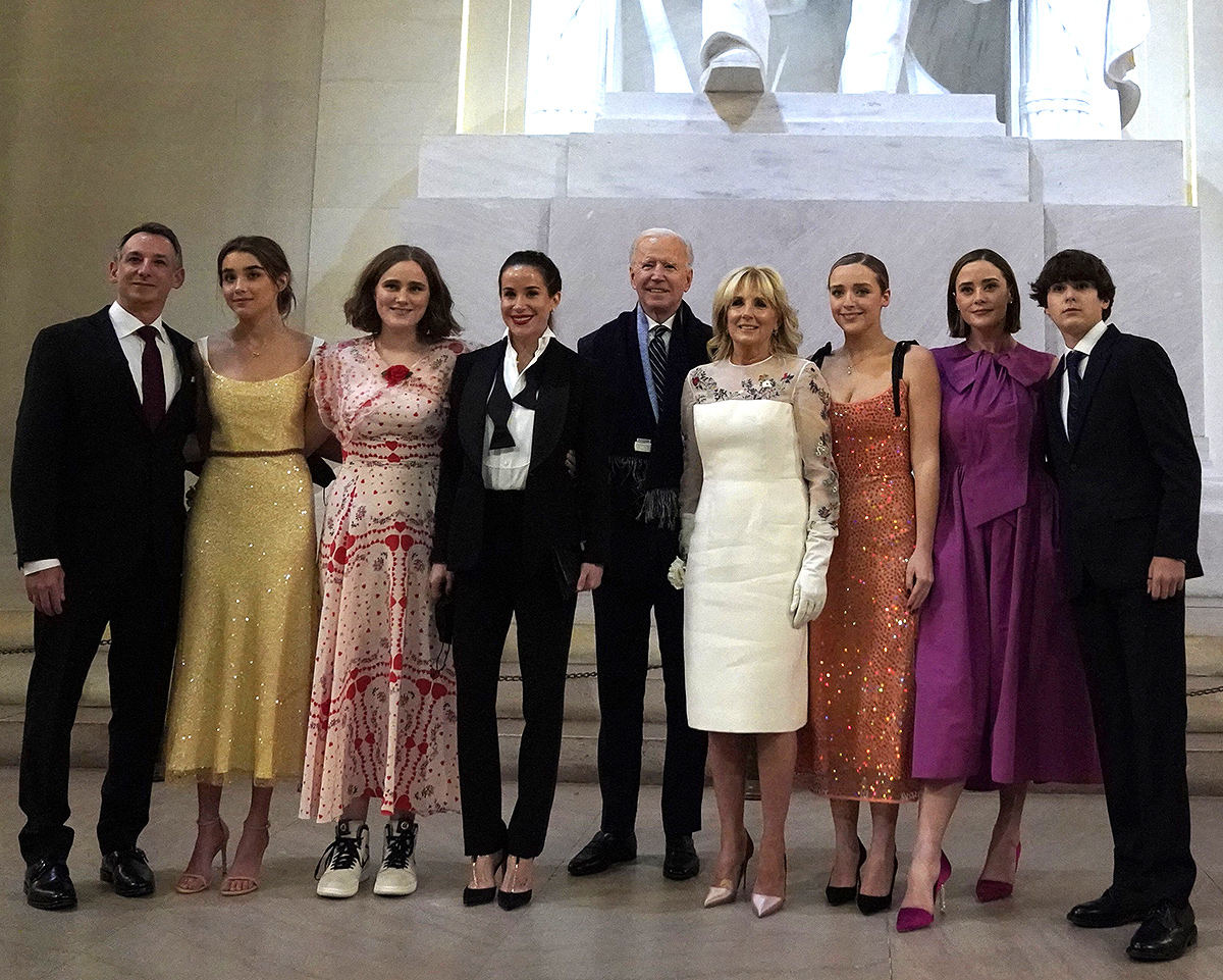 """US President Joe Biden and US First Lady Jill Biden pose with their family in front of the statue of Abraham Lincoln at the """"Celebrating America"""" event at the Lincoln Memorial after his inauguration as the 46th President of the United States in Washington, DC, January 20, 2021."""