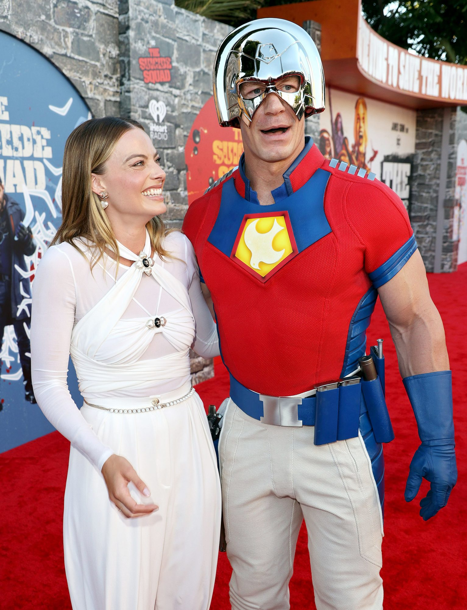 """Margot Robbie and John Cena attend the Warner Bros. premiere of """"The Suicide Squad"""" at Regency Village Theatre on August 02, 2021 in Los Angeles, California"""
