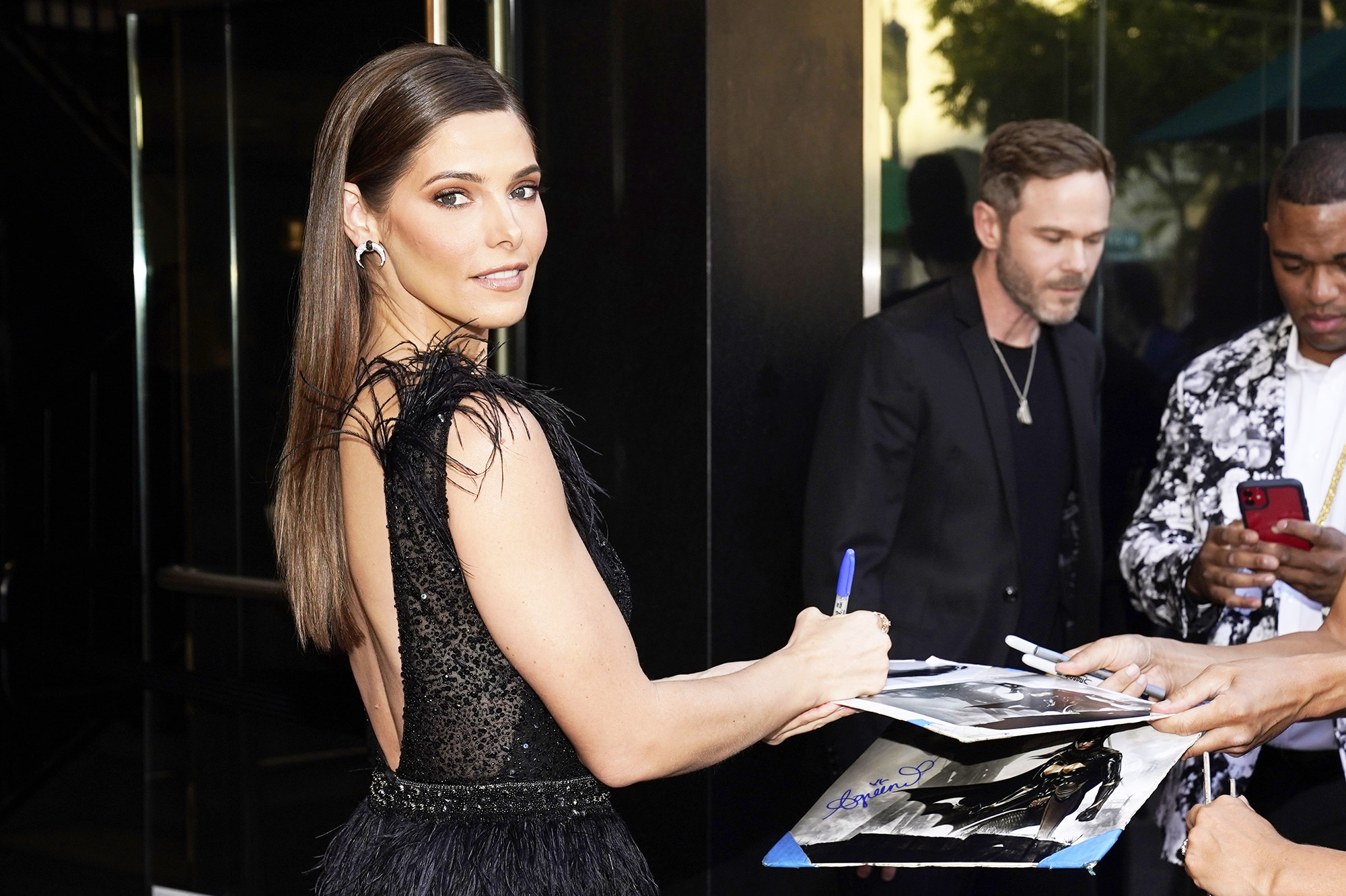 """Ashley Greene, a cast member in """"Aftermath,"""" signs autographs at the premiere of the film, at the Landmark Westwood in Los Angeles LA Premiere of """"Aftermath"""", Los Angeles, United States - 03 Aug 2021"""
