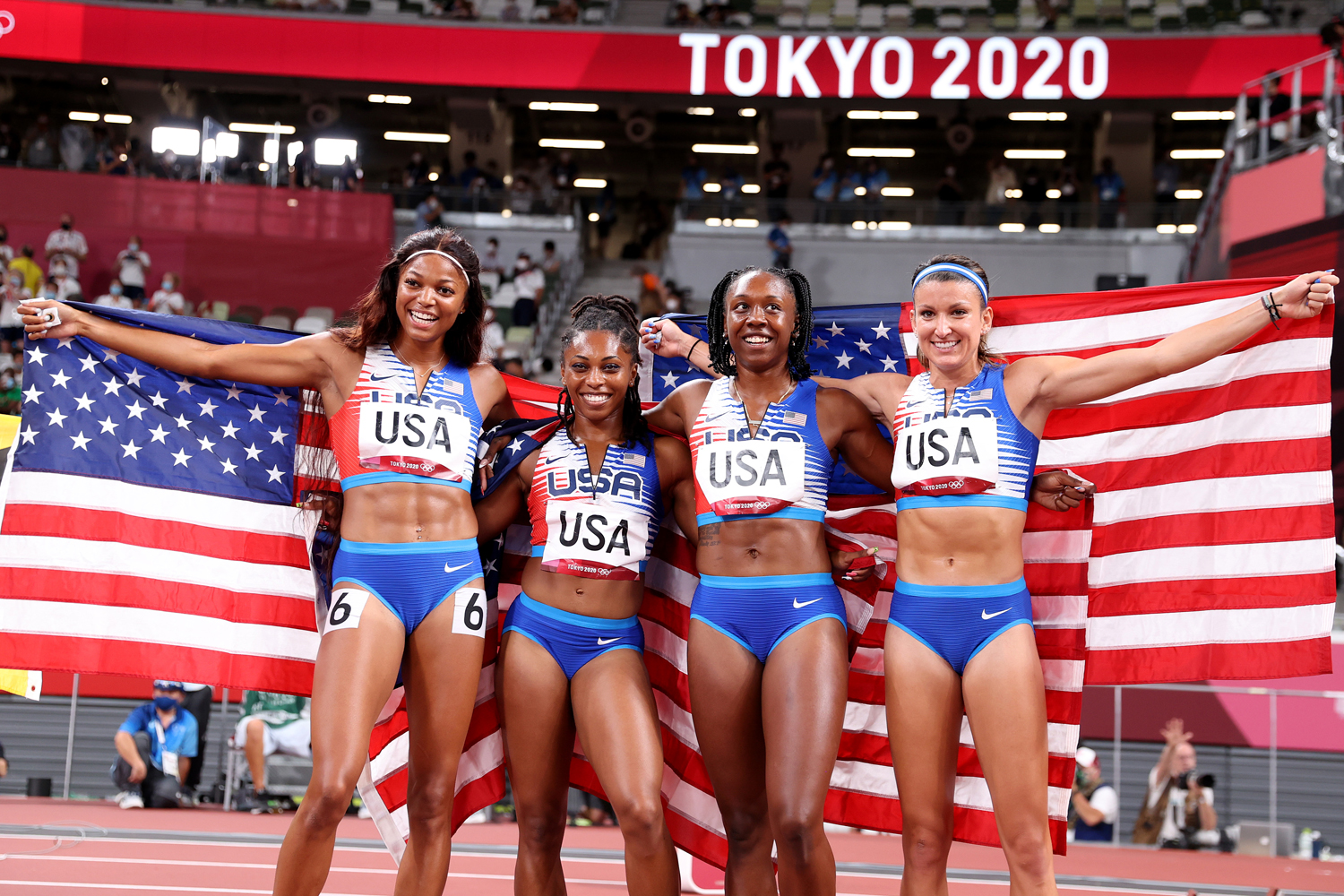 Javianne Oliver, Teahna Daniels, Jenna Prandini and Gabrielle Thomas of Team United States celebrate winning the silver medal in the Women's 4 x 100m