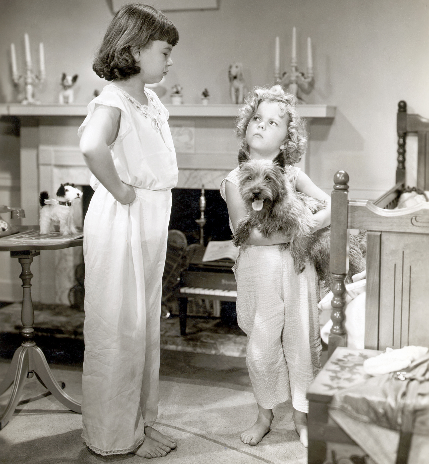 """Jane Withers objects to Shirley Temple's(right) dog """"Rags,"""" but Shirley steadfastly defends the up in a scene from """"Bright Eyes"""""""