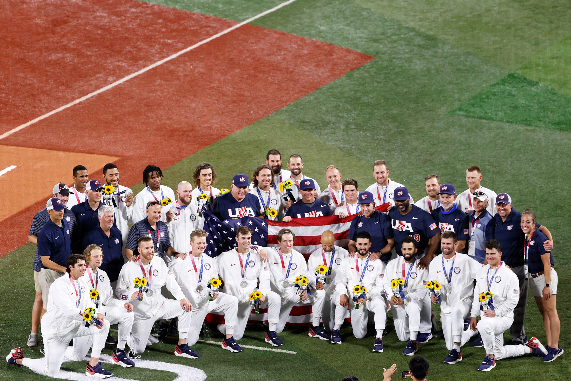 Silver medalists Team United States pose for photographs following the gold medal game between Team United States and Team Japan on day fifteen of the Tokyo 2020 Olympic Games at Yokohama Baseball Stadium on August 07, 2021 in Yokohama, Kanagawa, Japan