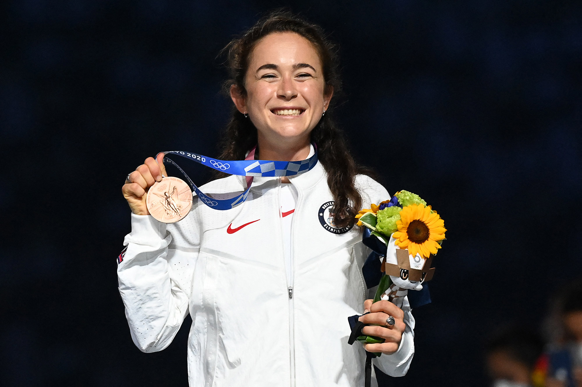 USA's Molly Seidel poses with her bronze medal during the victory ceremony of the women's marathon event during the Tokyo 2020 Olympic Games at the Olympic Stadium in Tokyo on August 8, 2021.