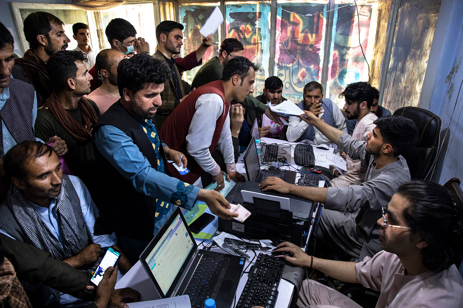 Afghan Special Immigrant Visa (SIV) applicants crowd into the Herat Kabul Internet cafe to apply for the SIV program on August 8, 2021 in Kabul, Afghanistan.