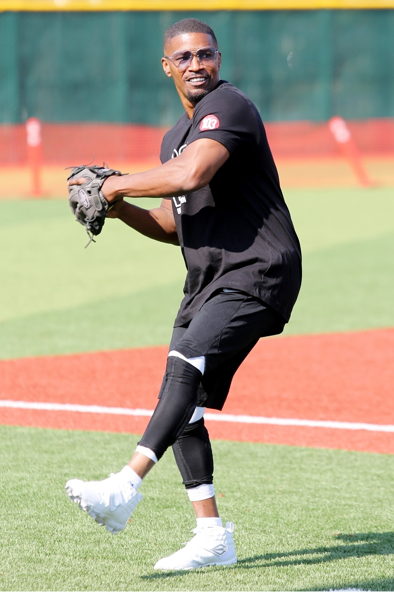 Jamie Foxx warms up before a game of baseball with Austin McBroom, Chris Tucker, and other celebrities in Hollywood.