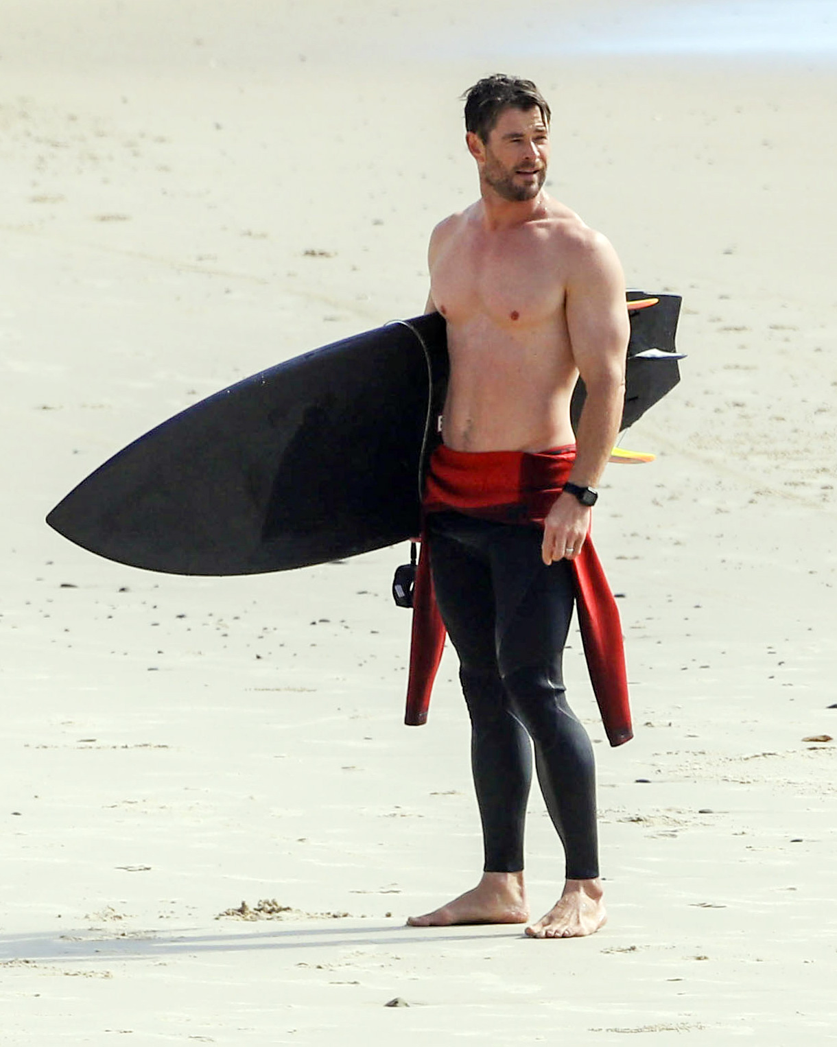 Chris Hemsworth and wife Elsa Pataky hit the beach for a morning surf and some exercise, amid the regional Covid lockdown in NSW, Australia.