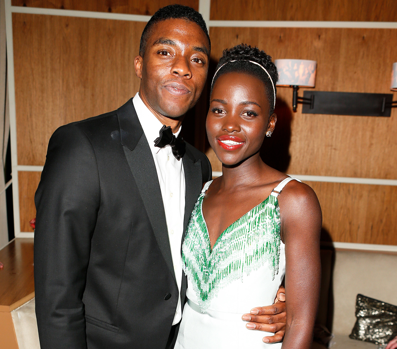 Chadwick Boseman and Lupita Nyong'o attend the 2014 Vanity Fair Oscar Party Hosted By Graydon Carter on March 2, 2014 in West Hollywood, California.