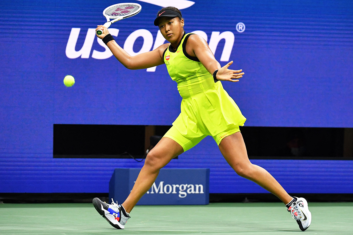 Japan's Naomi Osaka hits a return to Canada's Leylah Fernandez during their 2021 US Open Tennis tournament women's singles third round match at the USTA Billie Jean King National Tennis Center in New York, on September 3, 2021.