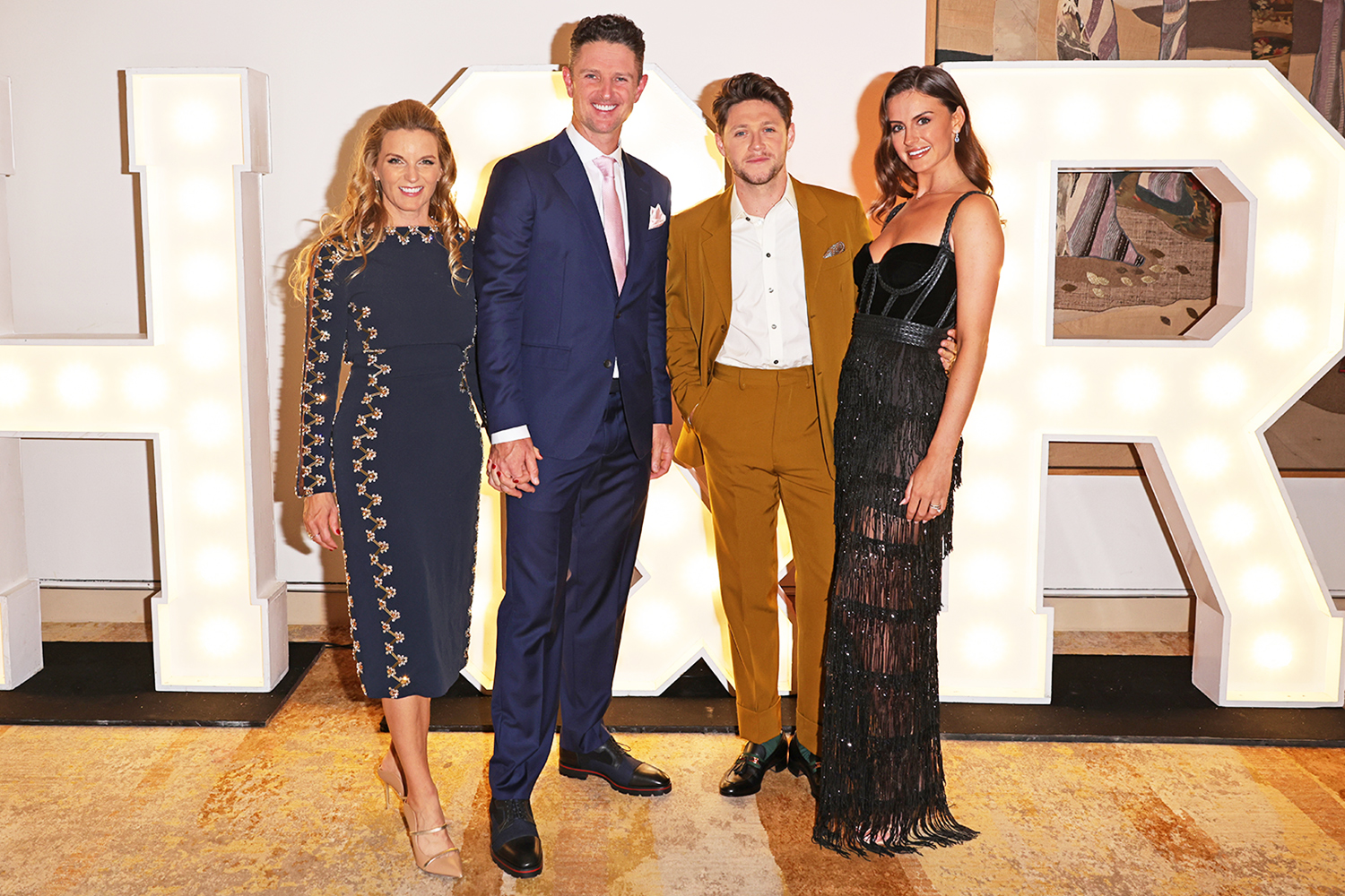 Kate Rose, Justin Rose, Niall Horan and Mia Woolley attend the Horan & Rose Show: Modest! Golf co-founder Niall Horan and Justin Rose brought the world of music and sport together at The Grove, presenting an evening of entertainment to raise money for The Black Heart Foundation on September 03, 2021 in Watford, England.