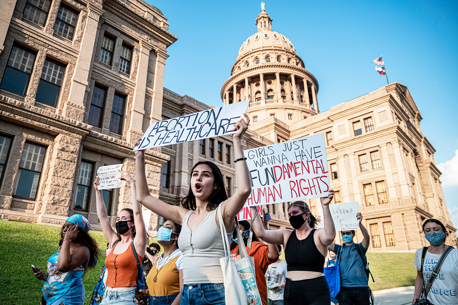 AUSTIN, TX - SEPT 1: Pro-choice protesters march outside the Texas State Capitol on Wednesday, Sept. 1, 2021 in Austin, TX. Texas passed SB8 which effectively bans nearly all abortions and it went into effect Sept. 1. A request to the Supreme Court to block the bill went unanswered and the Court still has yet to take any action on it.