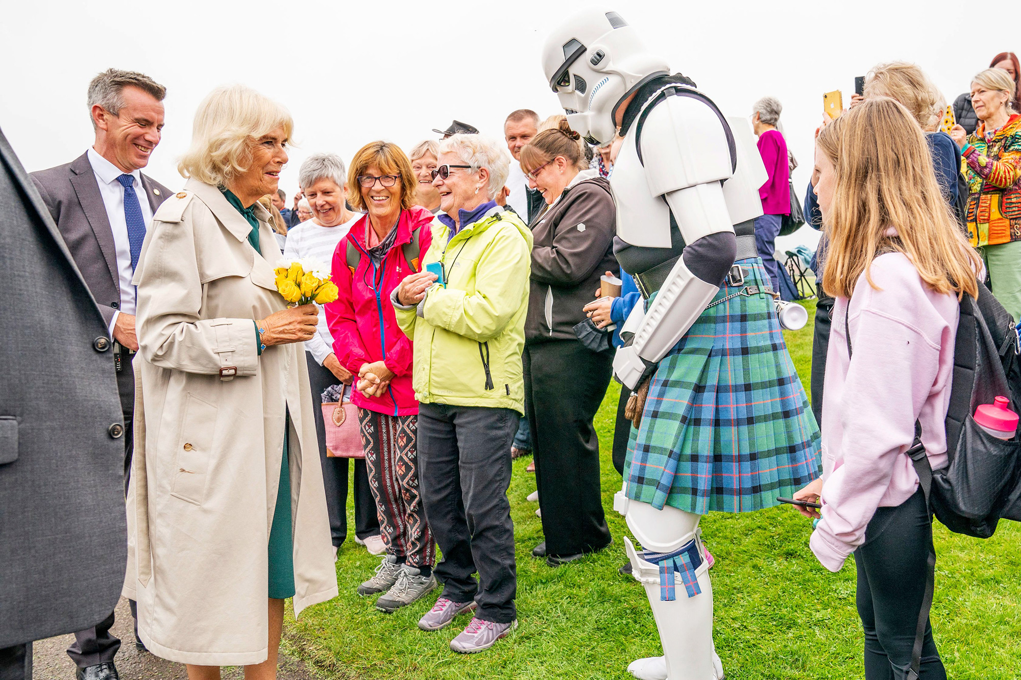 Britain's Camilla, Duchess of Cornwall (L) meets a person dressed as a Stormtrooper (2R) wearing a kilt at the opening of the Team Hamish Splashpad in Nairn, Scotland on September 10, 2021.