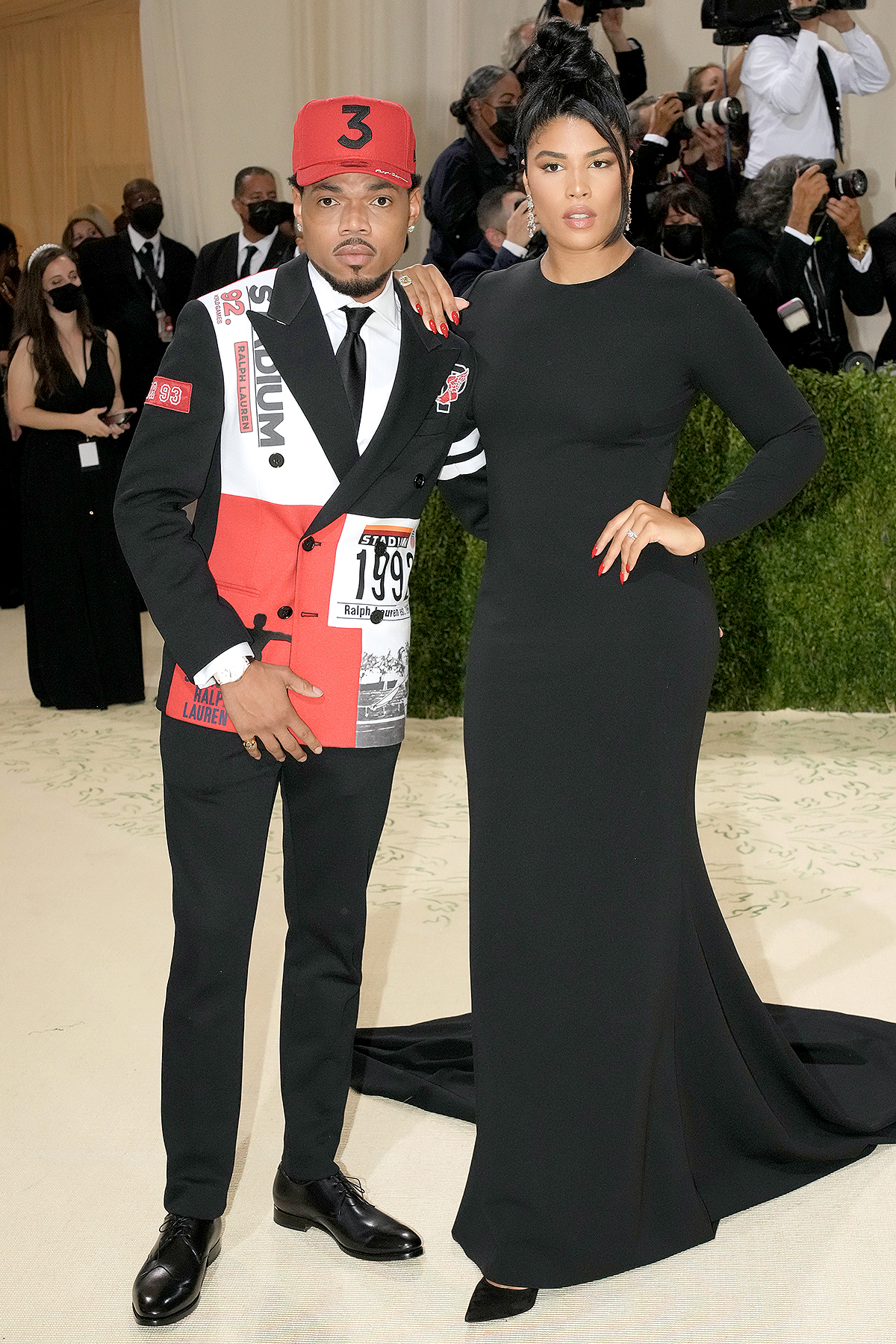 Chance the Rapper caption and Kirsten Corley attend The 2021 Met Gala Celebrating In America: A Lexicon Of Fashion at Metropolitan Museum of Art on September 13, 2021 in New York City.