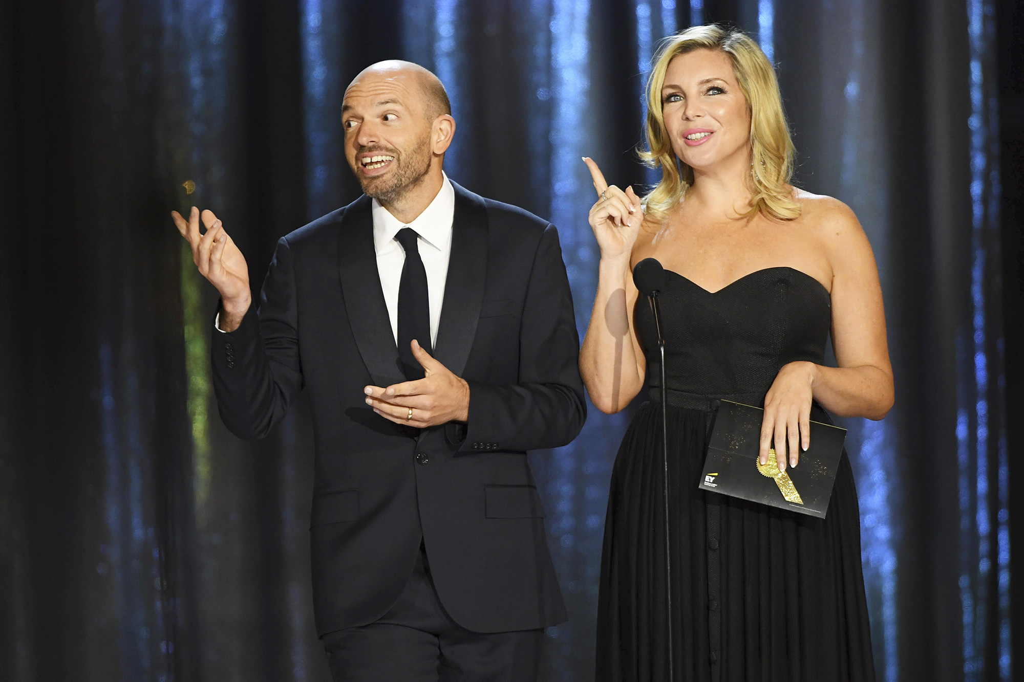 Paul Scheer, left, and June Diane Raphael appear on stage during night one of the Television Academy's 2021 Creative Arts Emmy Awards at the L.A. LIVE Event Deck, in Los Angeles 2021 Creative Arts Emmy Awards - Fixed Show - Night One, Los Angeles, United States - 11 Sep 2021