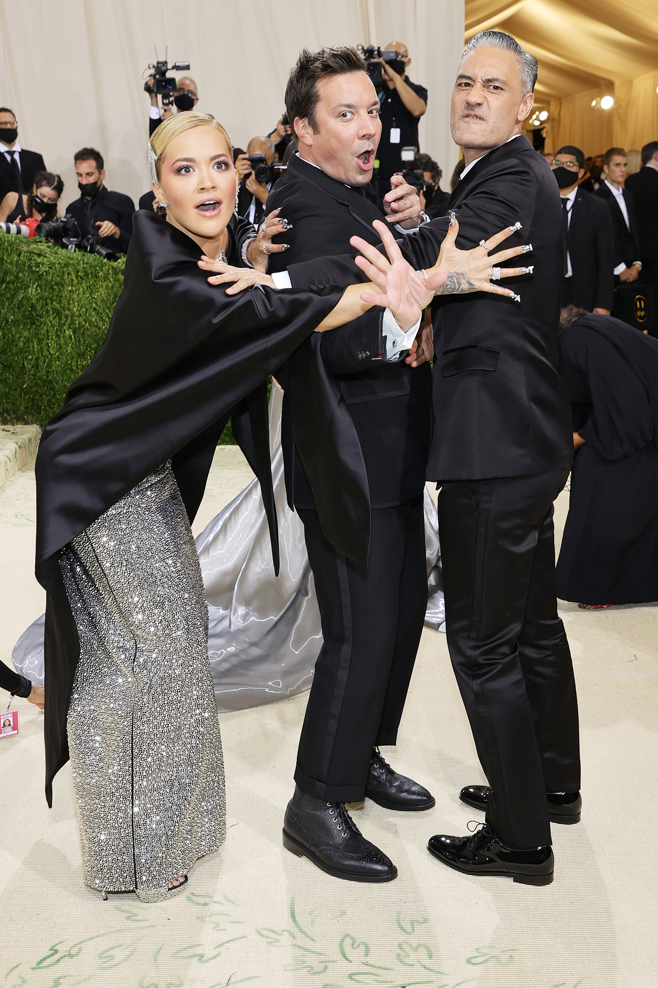 Rita Ora, Jimmy Fallon, and Taika Waititi attend The 2021 Met Gala Celebrating In America: A Lexicon Of Fashion at Metropolitan Museum of Art on September 13, 2021 in New York City.