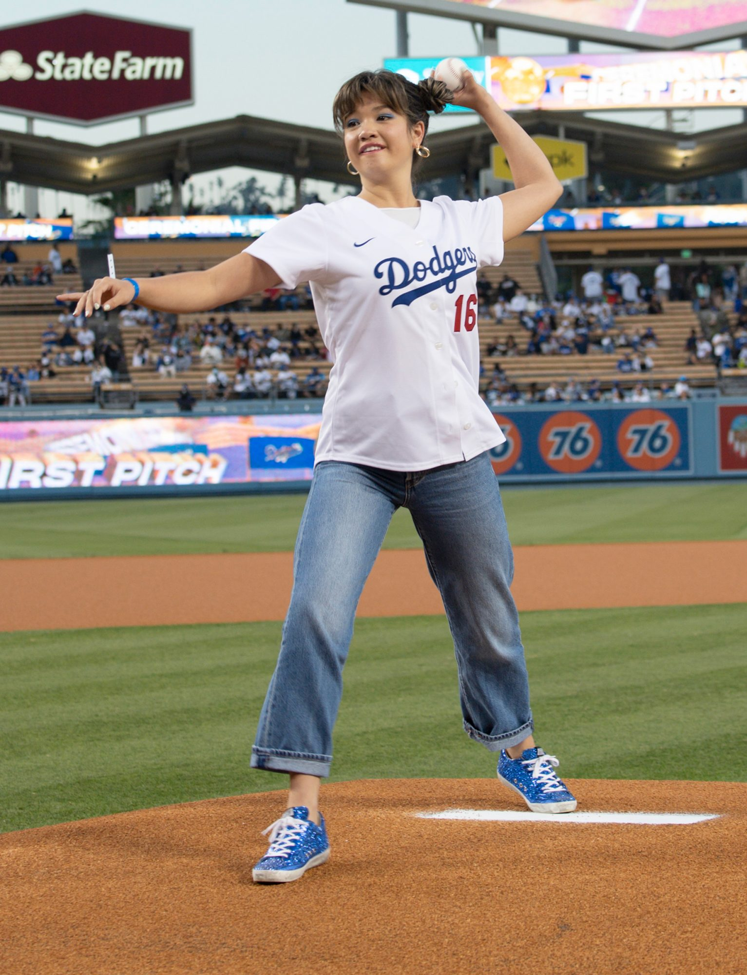 """Peyton Elizabeth Lee, star of the Disney+ Original Series """"Doogie Kamealoha, M.D.,"""" throws out the first pitch at the Los Angeles Dodgers versus Arizona Diamondbacks Game at Dodger Stadium on Tuesday, September 14"""