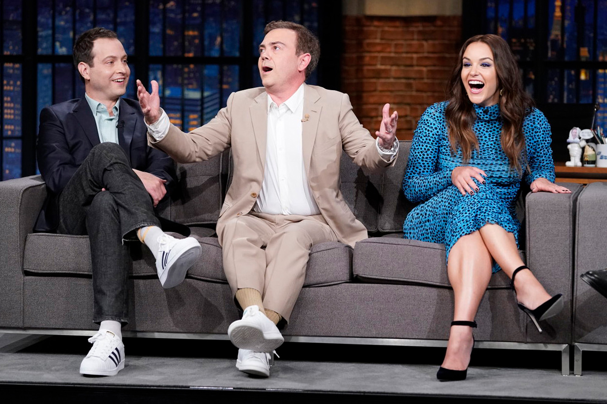 LATE NIGHT WITH SETH MEYERS -- Episode 1193A -- Pictured: (l-r) Brooklyn 99 co-creator Dan Goor and cast members Joe Lo Truglio and Melissa Fumero during an interview with host Seth Meyers on September 16, 2021
