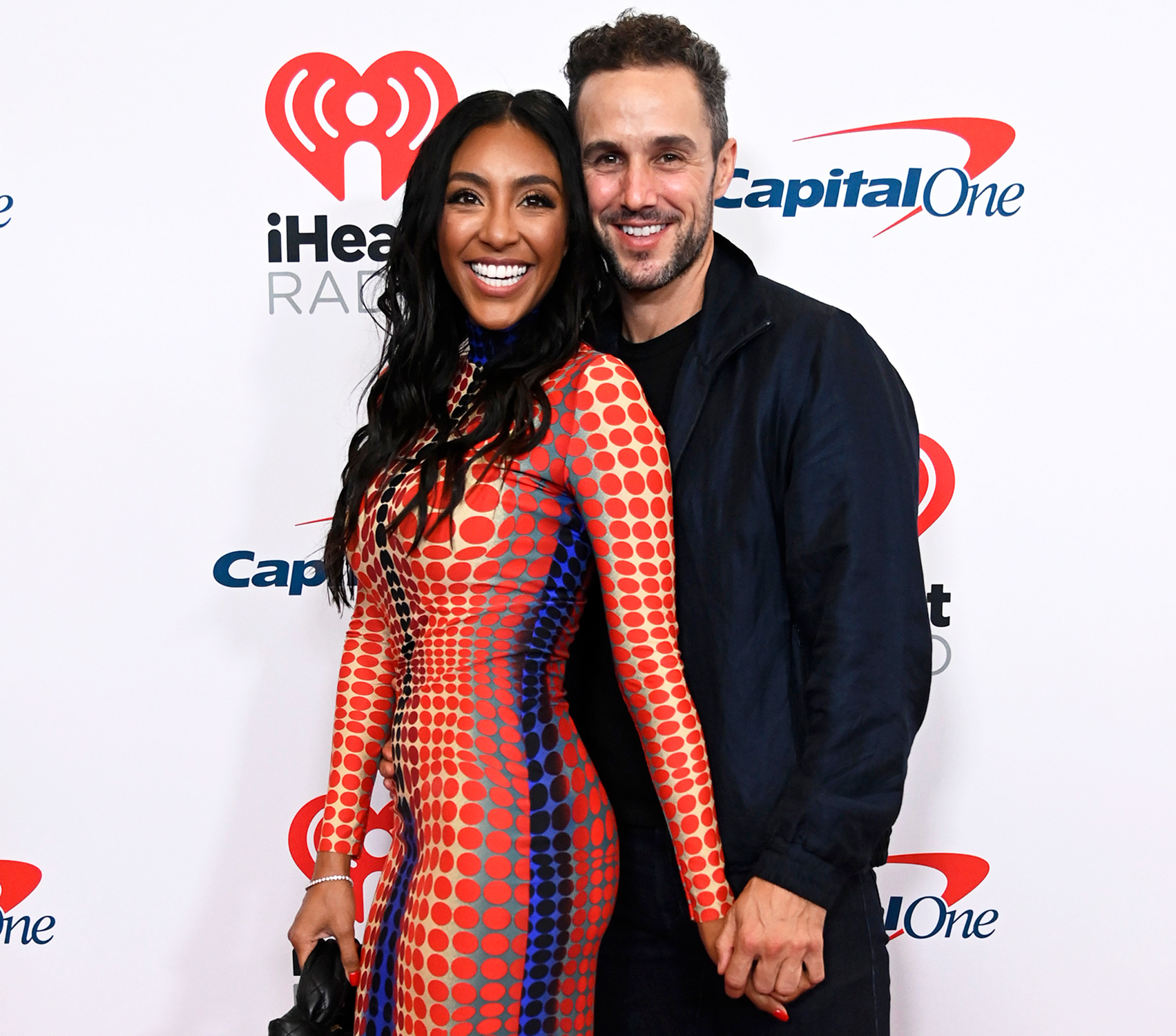 (L-R) Tayshia Adams and Zac Clark attend the 2021 iHeartRadio Music Festival on September 18, 2021 at T-Mobile Arena in Las Vegas, Nevada.