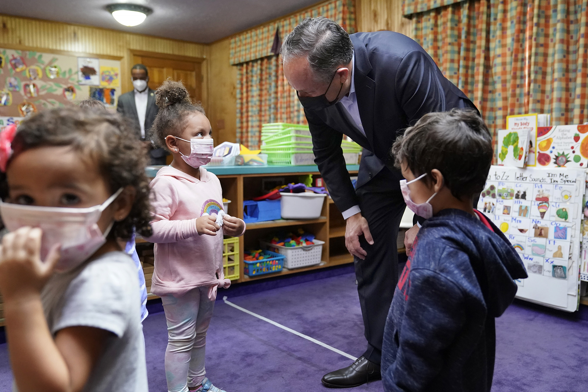 Douglas Emhoff, top right, husband of Vice President Kamala Harris, speaks to pre-school children after reading The Very Hungry Caterpillar, by Eric Carle, at Mother Hubbard Pre-School Center, in Milford, Mass. Emhoff visited the child care center to draw attention to the Biden administration's Build Back Better agenda Emhoff Massachusetts, Milford, United States - 20 Sep 2021