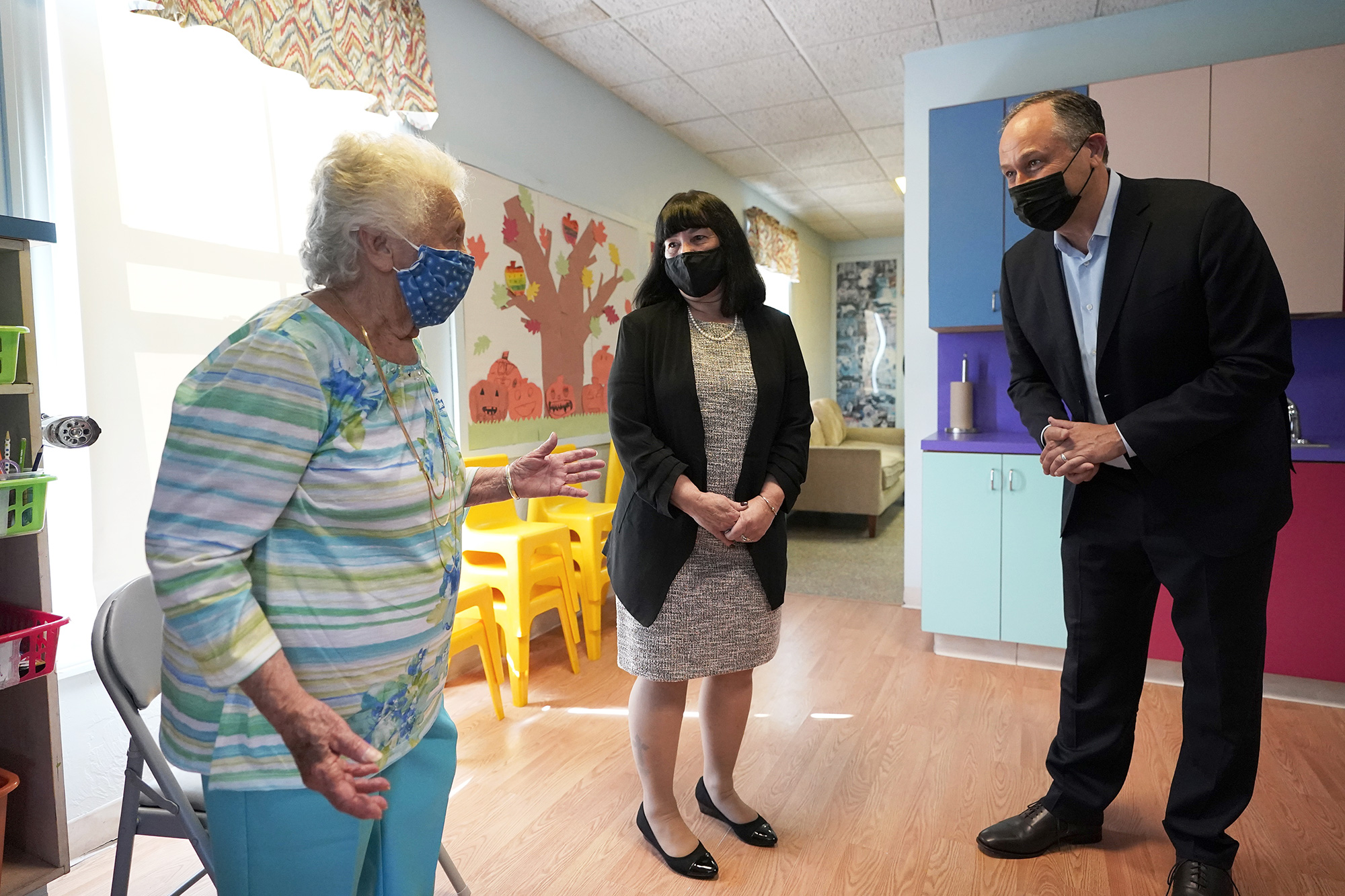 Douglas Emhoff, husband of Vice President Kamala Harris, right, speaks with Mother Hubbard Pre-School Center founder and owner 91-year-old Dorothy Vecchiolla, left, and Director Pamelia White, second from left, during a visit to the child care center, in Milford, Mass. Emhoff visited the child care center to draw attention to the Biden administration's Build Back Better agenda Emhoff Massachusetts, Milford, United