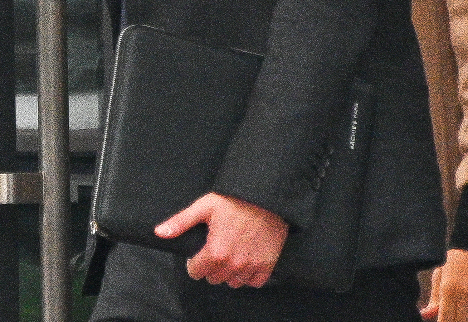 """Prince Harry, Duke of Sussex, with a portfolio briefcase inscribed with """"Archie's Papa,"""