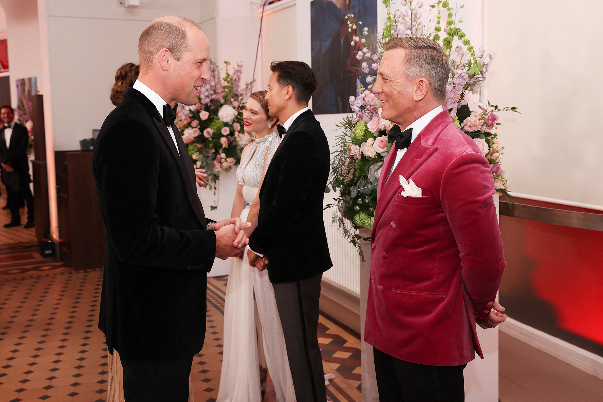 """Britain's Prince William, Duke of Cambridge (L) talks to English actor Daniel Craig ahead of the World Premiere of the James Bond 007 film """"No Time to Die"""" at the Royal Albert Hall in west London on September 28, 2021."""