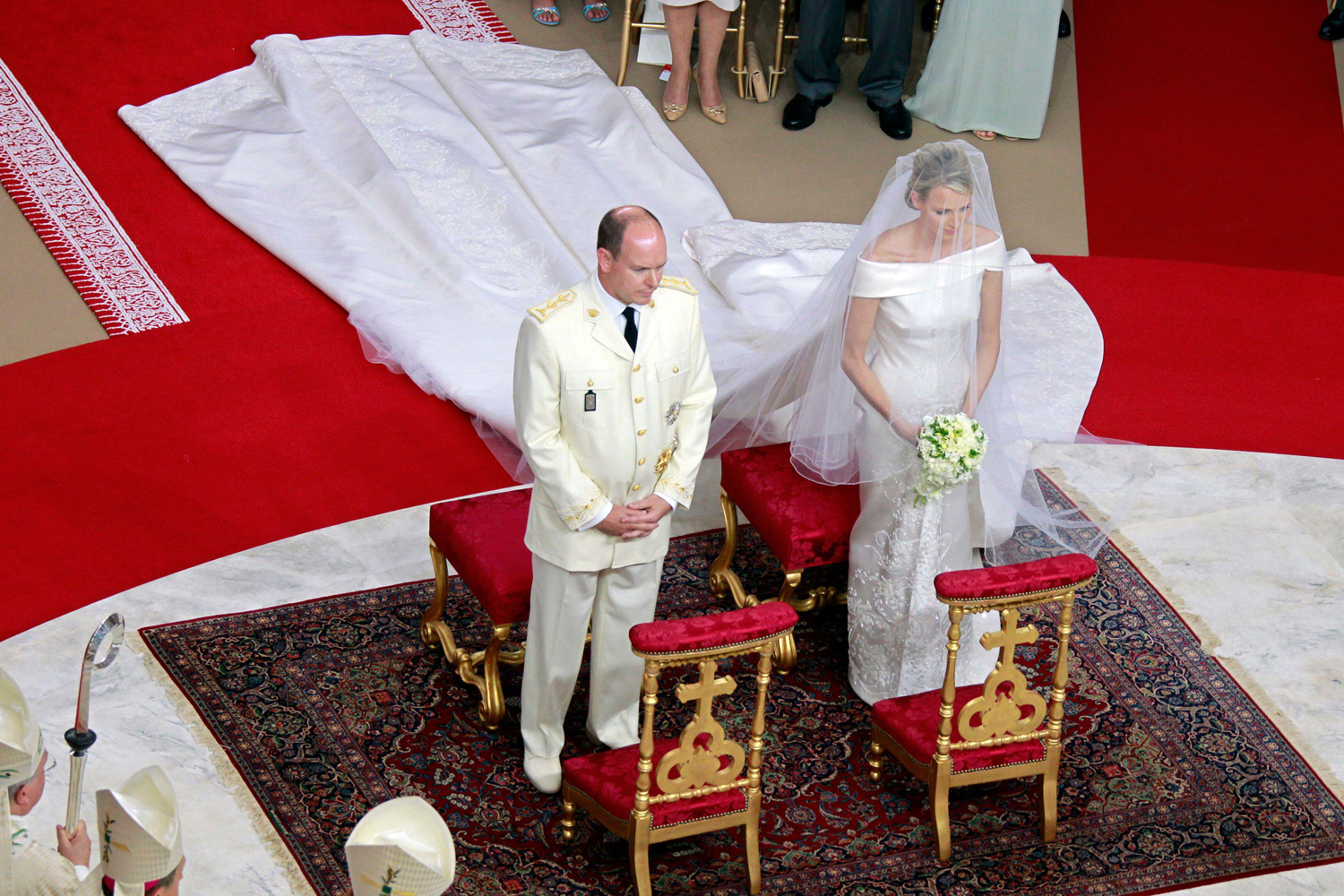 Prince Albert II and Princess Charlene stand at the altar during their religious wedding ceremony