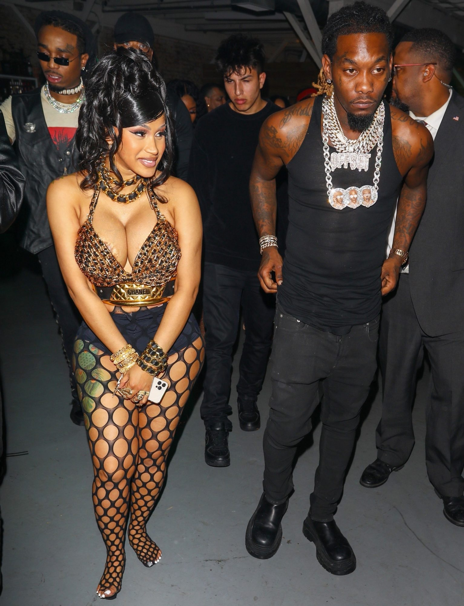 Cardi B is a showstopper as she exits her star-studded 29th birthday party with hubby Offset in Los Angeles. Cardi made sure to put her curvy physique on display donning an animal print bra-shirt with black fishnet stockings and heels.