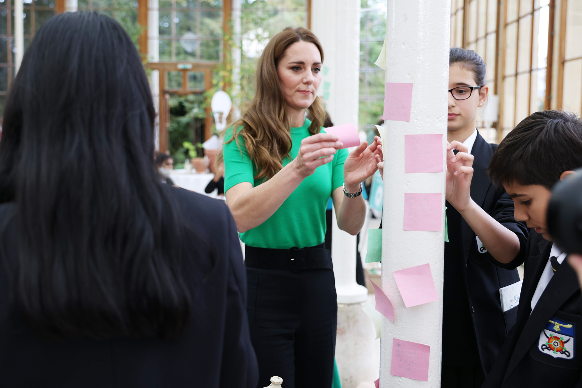 Britain's Prince William, Duke of Cambridge and Britain's Catherine, Duchess of Cambridge pose during their visit to take part in a Generation Earthshot educational initiative comprising of activities designed to generate ideas to repair the planet and spark enthusiasm for the natural world, at Kew Gardens, London on October 13, 2021.