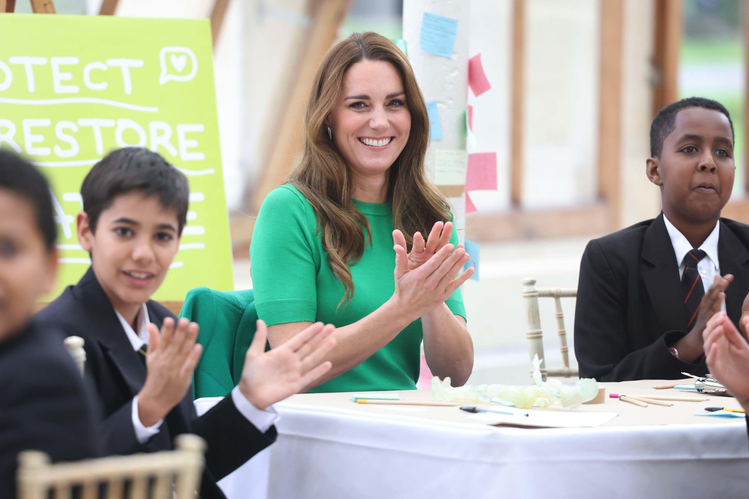 The Duke and Duchess of Cambridge with children from The Heathlands Schoo