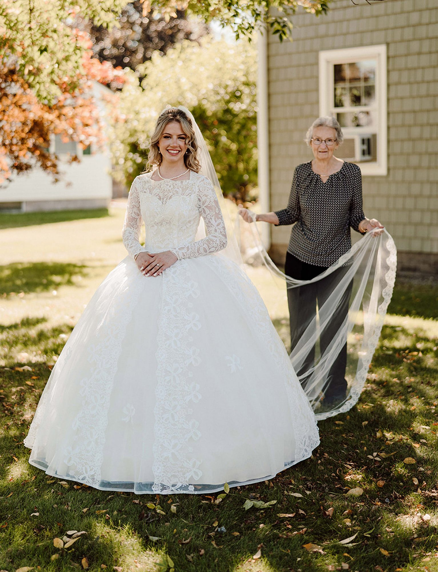 @keptyaphotography / MERCURY PRESS (PICTURED L-R Allie Livingwater and grandmother Anne Cooke) This woman has something borrowed and something old as she walked down the aisle wearing her grandma's 60-year-old wedding dress. Allie Livingwater, 23, tied the knot with Timothy, 27, on September 25 [2021] wearing her grandma Anne Cooke, 88, dress. The white laced gown was discovered in a black bin liner in 2016 and Allie immediately knew she wanted to wear it as 'something borrowed'. The long-sleeved dress required zero alterations but needed a clean after being stored in the basement since 1961. SEE MERCURY COPY