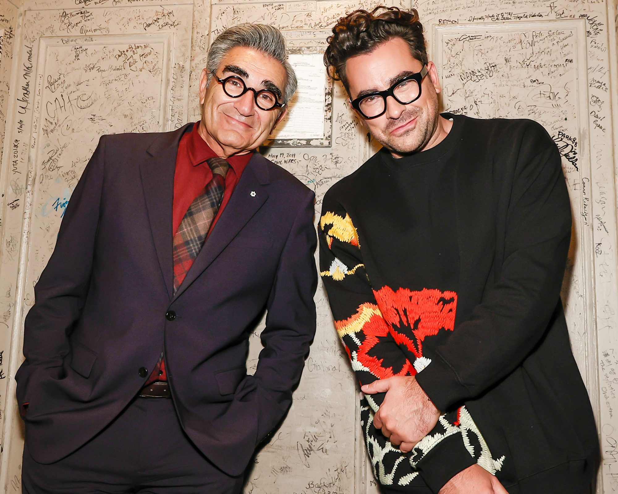 """Eugene Levy and Dan Levy are seen during the """"Best Wishes, Warmest Regards"""" book launch at The Beacon Theatre on October 25, 2021 in New York City"""