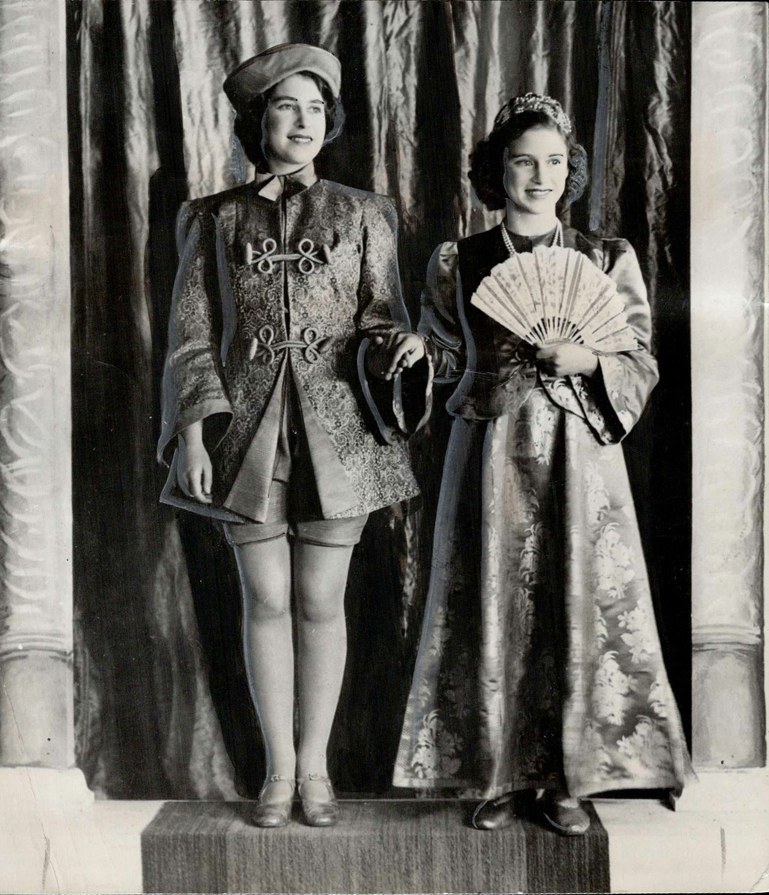 Princess enjoyed playing roles in pantomimes held every Christmas Elizabeth is shown here; left; as Aladdin; Margaret Rose taking Princess Roxana part.
