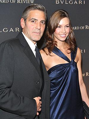 George Clooney y Sarah Larson