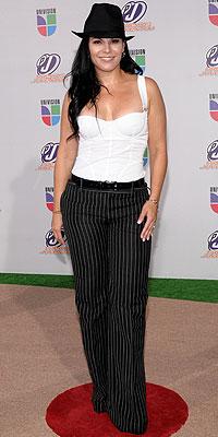 Olga Tañón, Desastres en la alfombra