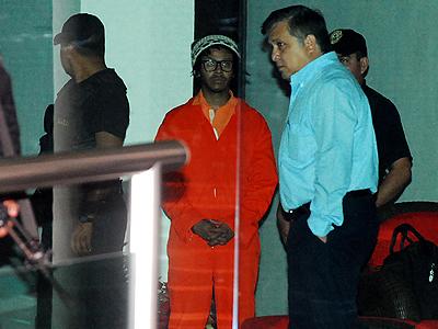 Kalimba y su uniforme de recluso