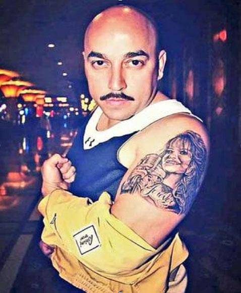 Lupillo Rivera, tatuaje, Jenni