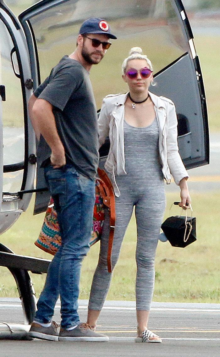 Liam Hemsworth , Miley Cyrus
