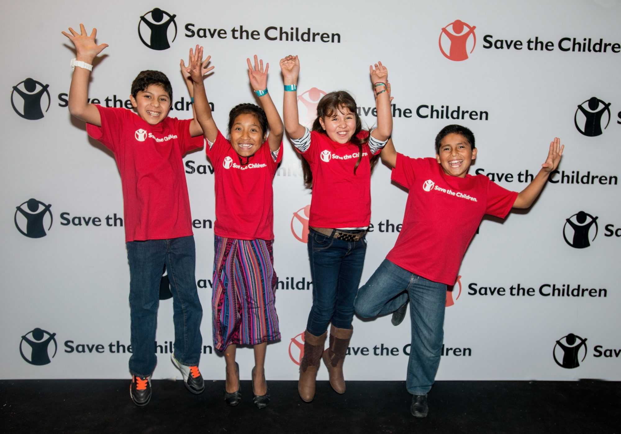 Photos are Embargoed until Tuesday December 13th, 2016. EXCLUSIVE PHOTO FOR PEOPLE: From left, Gerson, Juana, Henely and Julio jump for joy after meeting international pop star Enrique Iglesias before his Dec. 9, 2016, concert in Guatemala City, Guatemala. The kids, who all participate in Save the Children's Literacy Boost program in Guatemala, created a handmade book as a thank you gift for Iglesias, who, through a partnership with Microsoft, has donated $200,000 in software to Save the Children to strengthen its literacy programming for elementary school-age children in El Salvador, Guatemala and Peru.