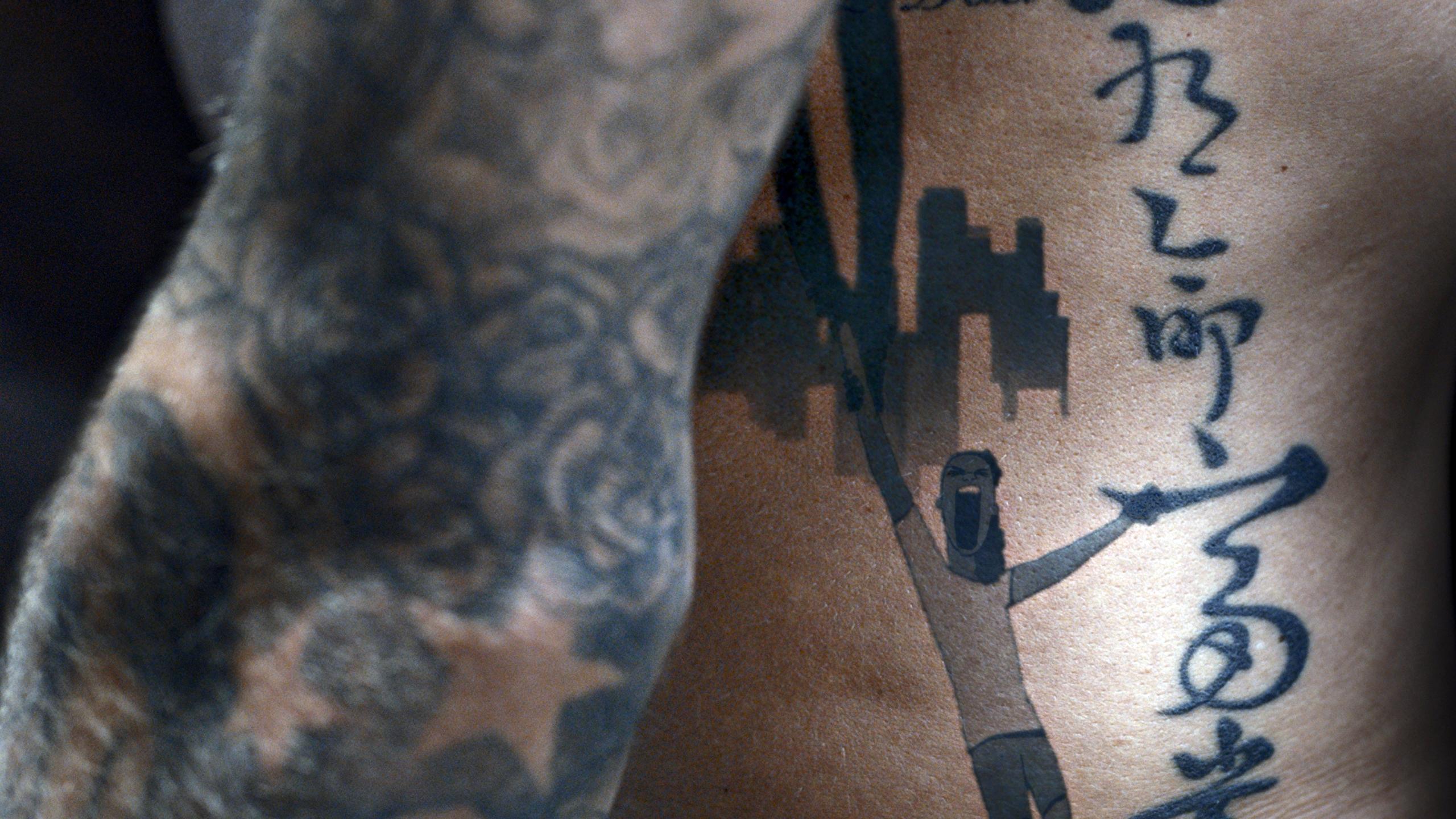 David Beckham Displays his Tattoos for Charity