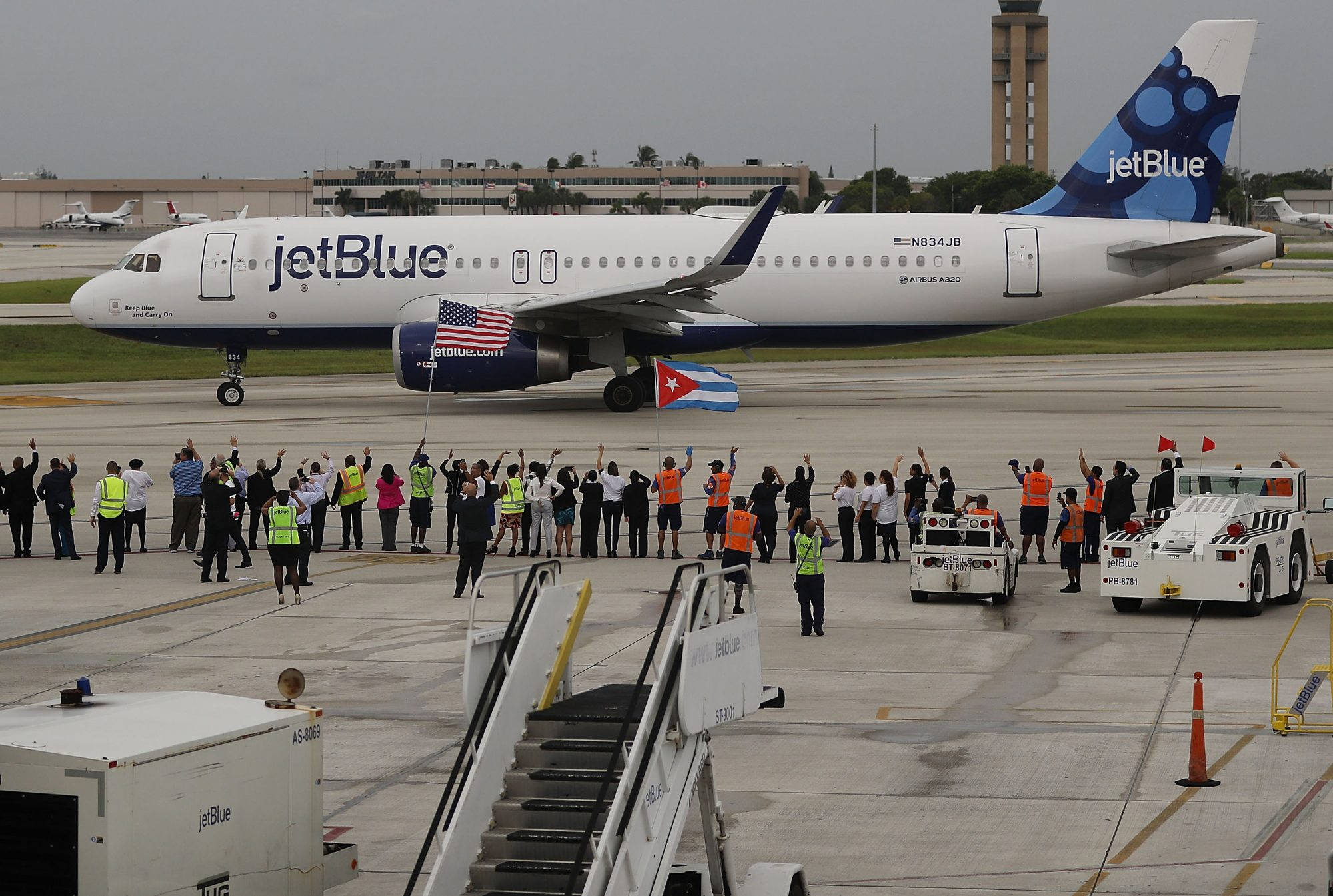 FORT LAUDERDALE, FL - AUGUST 31: Workers and officials watch as JetBlue Flight 387 prepares for take off as it becomes the first scheduled commercial flight to Cuba since 1961 on August 31, 2016 in Fort Lauderdale, Florida. JetBlue which hopes to have as many as 110 daily flights is the first U.S. airline to resume regularly scheduled airline service under new rules allowing Americans greater access to Cuba. (Photo by Joe Raedle/Getty Images)