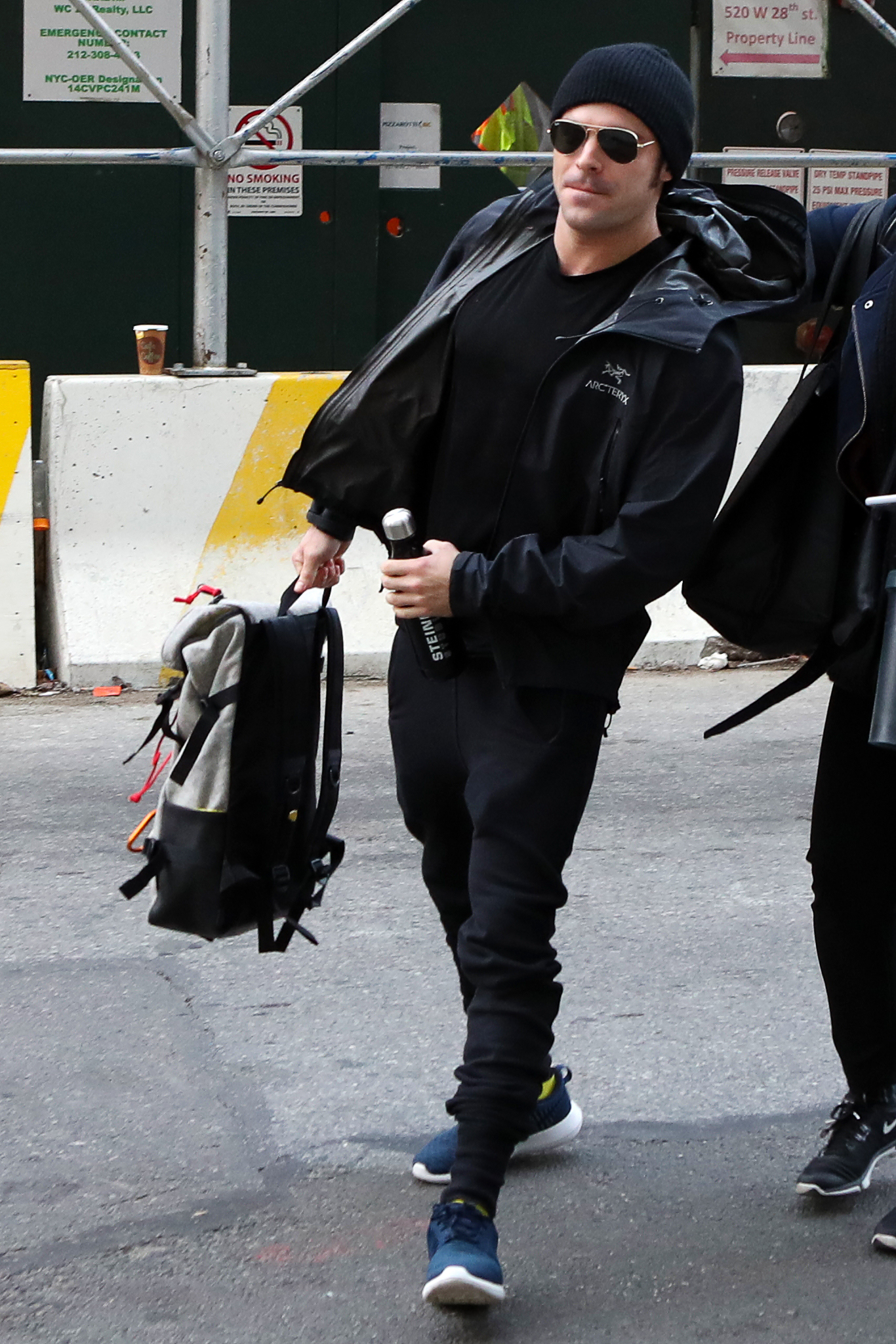 EXCLUSIVE Zac Efron Looks Cool In All-Black As He Runs Into A Studio In NYC