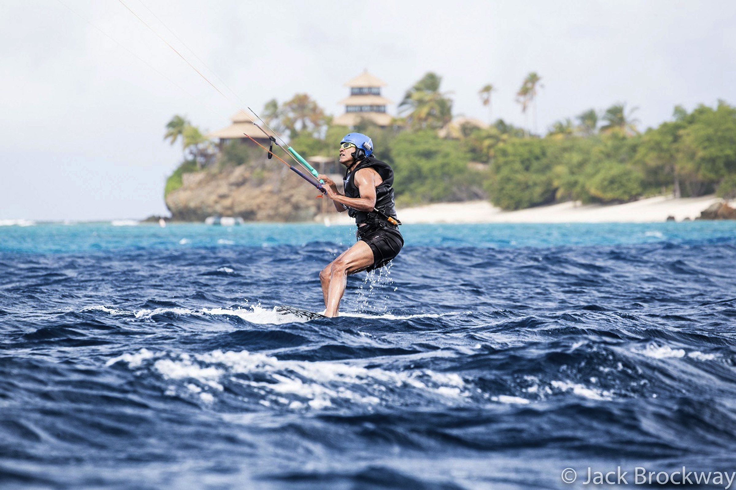 In this recent but undated photo made available by Virgin.com, former U.S President Barack Obama kitesurfs during his stay on Moskito Island, British Virgin Islands. The former president and his wife stayed on Mosikto Island owned by Richard Branson, founder of the Virgin Group, after he finished his second term as President and left the White House. (Jack Brockway/Virgin.com via AP)