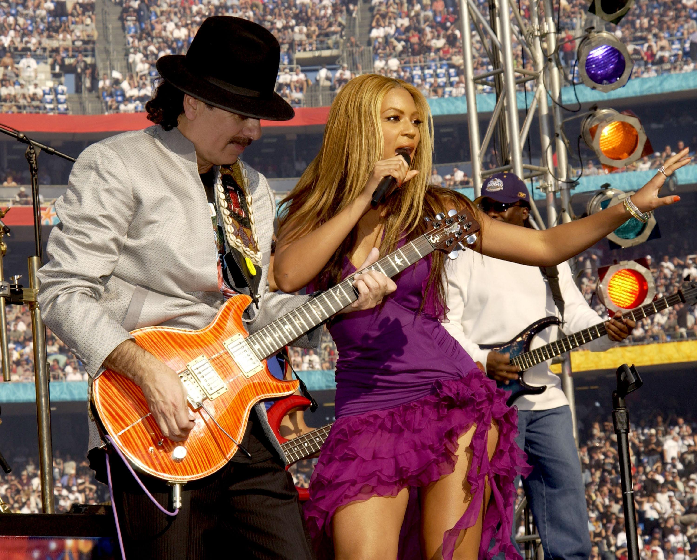 Carlos Santana y Beyonce Knowles